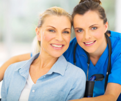 woman and caregiver smiling