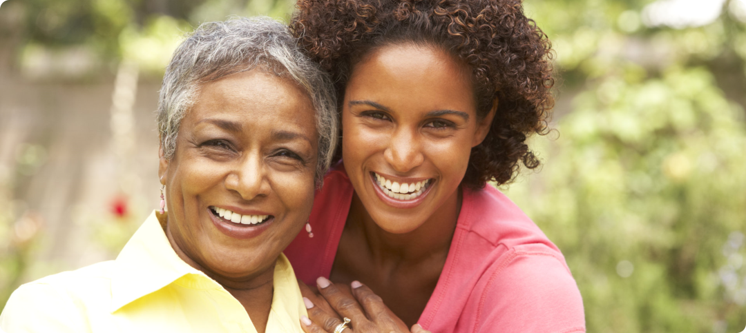 smiling grandma with her caregiver