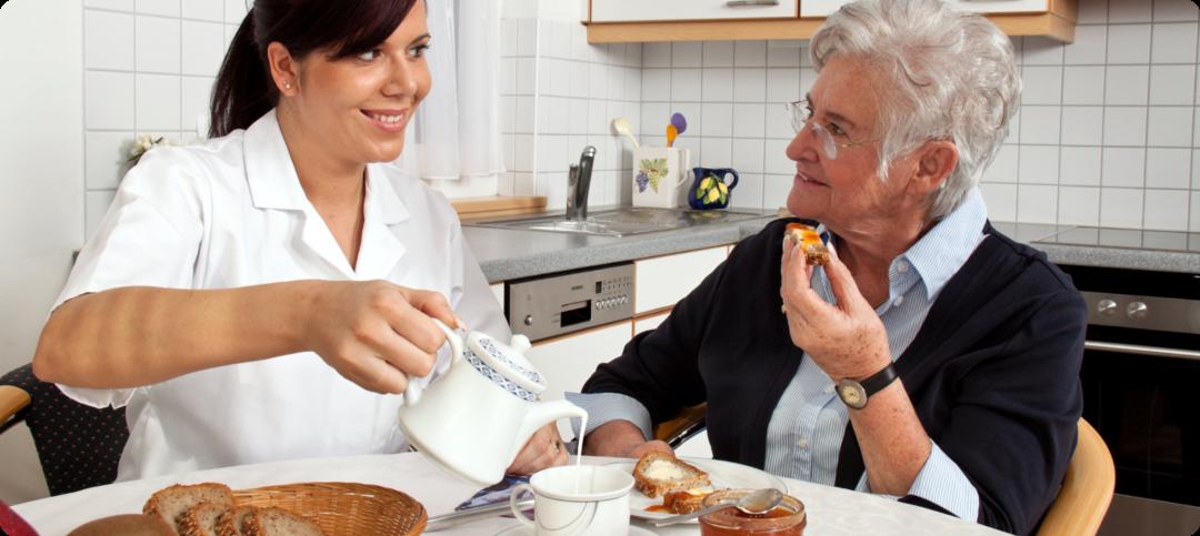 caregiver is preparing meals for her patient